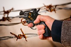 Hand Holding a Charged Revolver. Detail of Hand Holding a Charged Revolver royalty free stock image