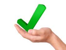 Hand holding check mark icon. success concept Stock Photos