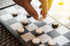 Hand holding checker board with checkers. Hand holding checker board with checkers game stock image