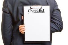 Hand holding checklist on clipboard Stock Photos