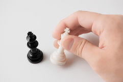 Hand holding a chess piece on white background. Close-up photography Royalty Free Stock Photos