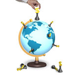 Hand holding chess with terrestrial globe Stock Photography
