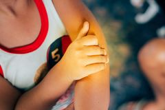 Hand holding children`s elbow. Elbow pain concept Royalty Free Stock Photo