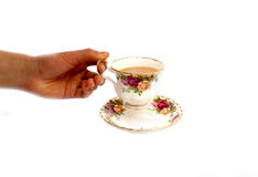 Hand holding china cup and saucer Stock Photography