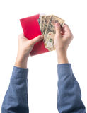 Hand holding chinese red envelope with money isolated over white background. Stock Image
