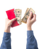 Hand holding chinese red envelope with money isolated over white background Stock Photos