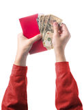 Hand holding chinese red envelope with money isolated on white Stock Photos