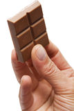 Hand holding chocolate Royalty Free Stock Photography