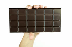Hand holding chocolate bar Royalty Free Stock Photos