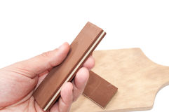 Hand holding chocolate Stock Photography