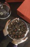 Hand holding chocolate bonbons Stock Photo