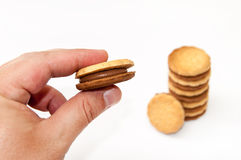 Hand holding chocolate sandwich biscuits Stock Images