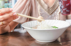 Hand holding chopstick take meatball Royalty Free Stock Photography