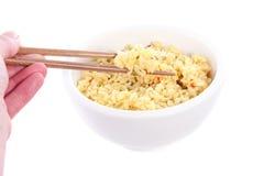Hand holding chopsticks Stock Image