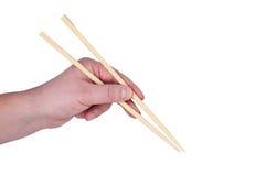 Hand holding chopsticks. Stock Photo