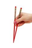 Hand holding chopsticks Royalty Free Stock Photo