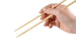 Hand holding the chopsticks. Isolated on a white background Royalty Free Stock Images