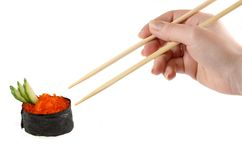 Hand holding the chopsticks. Isolated on a white background Stock Image