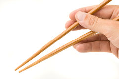 Hand holding chopsticks. Royalty Free Stock Image