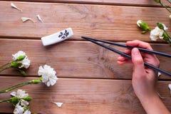 Hand holding chopsticks Royalty Free Stock Photography