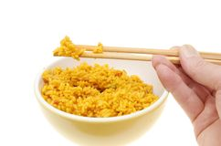Hand holding chopsticks and rice Stock Photo