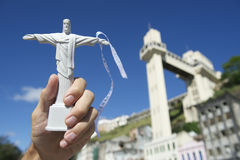 Hand Holding Christ Souvenir at Salvador Brazil Lacerda Elevator Royalty Free Stock Images