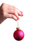 Hand holding a Christmas ball Stock Photos