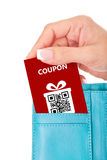 Hand holding christmas coupon in wallet isolated over white. Background Stock Image