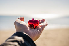 Hand holding Christmas heart Stock Photography