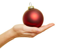 Hand holding christmas tree ball Stock Photography