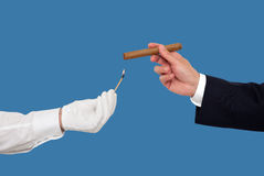 Hand holding a cigar Stock Images