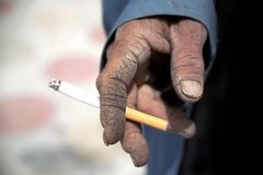 Hand holding cigarette Stock Photography
