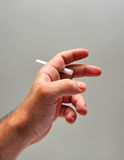 Hand holding a cigarette Royalty Free Stock Photos