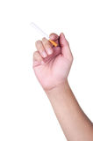 A hand holding a cigarette Royalty Free Stock Photos