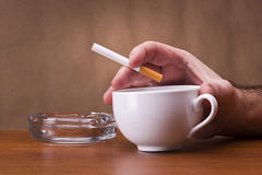 Hand holding a cigarette Stock Image