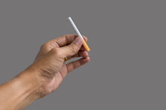 Hand holding a cigarette Royalty Free Stock Image