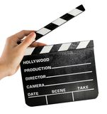A hand holding a clapper board Stock Images
