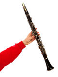 Hand holding clarinet Stock Photos