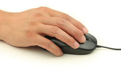 Hand Holding and Clicking Computer Mouse Stock Image