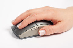 Hand Holding and Clicking Computer Mouse Royalty Free Stock Photos
