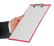 Hand holding clipboard Stock Photo