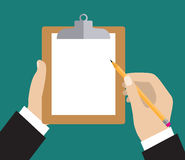 Hand holding clipboard with blank sheet Royalty Free Stock Photos
