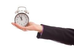 Hand holding clock Stock Image