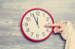 Hand holding clock Royalty Free Stock Images