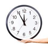 Hand holding a clock Stock Photos