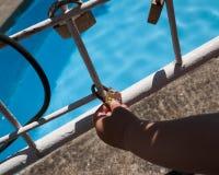 Hand holding a closed padlock Stock Photo
