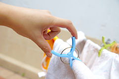 Hand holding clothes pegs Royalty Free Stock Photo