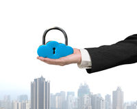 Hand holding cloud shape locker with city view Stock Image