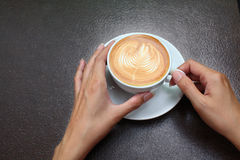 Hand holding coffee cup. royalty free stock images
