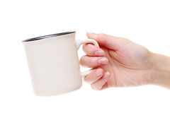 Hand holding coffee cup Stock Images